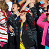 The Jeffersonville Fire Department visited Thomas Jefferson Elementary School Friday morning to discuss fire prevention and safety for National Fire Prevention Week.  Kindergarten students Aubrey Roberts, left, Andrew Farnsley and Olivia Ridge look up for a aerial photograph taken of the student body by the fire department.  Staff photo by C.E. Branham