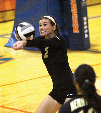 Henryville senior Allison Knox keeps a ball in play Thursday night at Silver Creek.  Staff photo by C.E Branham