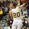 New Albany guard A.J. Schmidt is fouled by Floyd Central forward Nick Bomersbach.  New Albany came from behind for a 58-57 overtime win at Floyd Central.  Staff photo by C.E. Branham