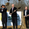 Director of Tennis Yhale Scott, left, investor David Lewis, center, and managing partner Bob Sutherland toss dirt at a ceremonial ground breaking for the Southern Indiana Tennis Center.  The indoor tennis facility in Clarksville is expected open in march. Staff photo by C.E. Branham