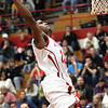 Jeffersonville junior guard Darryl Baker scored in the first half against Silver Creek with a slam.  Staff photo by C.E. Branham