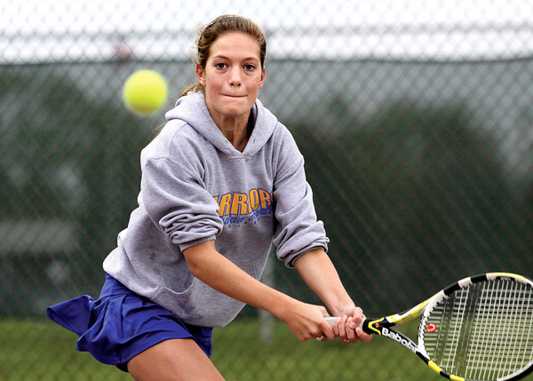 Courtney Heishman, playing No. 2 singles for Christian Academy of Indiana, returns volley to Cllarksville player Jackie Slaten in a opening match of the Jeffersonville Invitational.  Staff photo by C.E. Branham