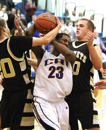Christian Academy of Indiana forward Devonta King is fouled on a rebound by Henryville player Tyler Collins with 26 seconds to play and the Warriors leading 51-49.  Christian Academy won 55-49 Tuesday night.  Staff photo by C.E. Branham