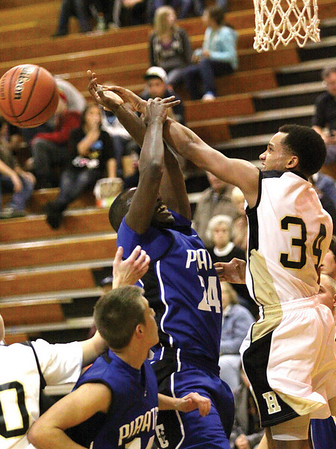 Henryville guard Andrew Jones knocks the ball away from Charlestown player Kendall Thompson Tuesday night.  Staff photo by C.E. Branham