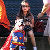 Isabelle Vittitow and her boxer Rowdy potrayed Superman and Lois Lane at the Harvest Homecoming Dog Show Monday evening.   Vittitow and Rowdy placed second in the best costume category.  Staff photo by C.E. Branham