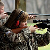 Megan Weisenbach eyes her target as she and 34 Borden High School students participated in a turkey shoot Monday at the Southern Indiana Rifle and Pistol Club.  Students paid $5 for a shot to win one of ten turkeys donated by Bass Pro.  The students entry fees were donated to the Borden Lions Club.  Staff photo by C.E. Branham