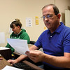 Republican appointee Gary Law and Democrat appointee Sherry Lockard are processing a large number of absentee ballot applications in the Clark County voter registration office for the upcoming municipal election.  Staff photo by C.E. Branham