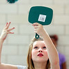 Maple Elementary School fifth-grader Justice Jansing uses a mirror to toss a ball into a cauldron.  Students are going through 12 Halloween theme stations in gym class that involve coordination and team work skills.  Staff photo by C.E. Branham