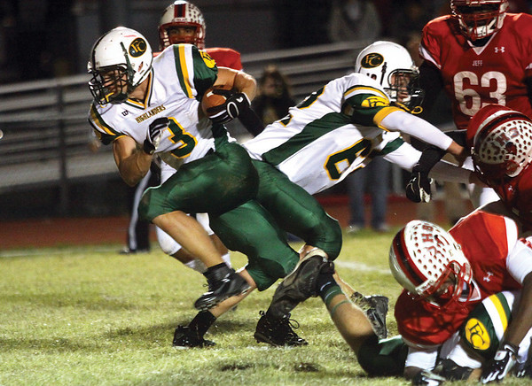 Floyd Central running back Kyle Bramble breaks through the Jeffersonville defensive line for a seven-yard touchdown Friday night in 5A sectional play.  Staff photo by C.E. Branham