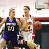 Borden senior Allison Rademacher takes the ball the length of the floor for a basket with Lanesville defender Brooklynn Keinsley Thursday night at Borden.  Staff photo by C.E. Branham