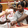 New Jeffersonville High School girls basketball coach Jana Costner breaks a timeout with the white team during a scrimmage Wednesday night.  Staff photo by C.E. Branham