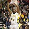Floyd Central center Jordan Thompson lays in two points against New Albany Friday night.  Staff photo by C.E. Branham