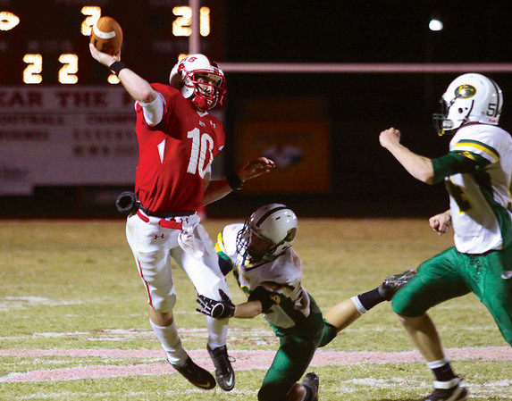 Jeffersonville quarterback Dalton Conway gets off a pass ahead of Floyd Central defender Chase Herron for a 20-yard touchdown reception to Dionte Allen.  Staff photo by C.E. branham
