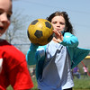 Lily Haire tries to tag a runner in a game of kick ball at the YMCA of Southern Indiana spring break camp in Jeffersonville. Staff photo by C.E. Branham