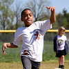 Cameron Allen heads to third base in a game of kick ball at the YMCA of Southern Indiana spring break camp in Jeffersonville. Staff photo by C.E. Branham