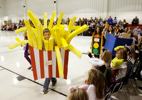 Fifth-grader Saben Conte walks around the gymnasium in his homemade french fries costume during the St. Paul Catholic School Parade of Costumes in Sellersburg on Wednesday afternoon. Staff photo by Christopher Fryer