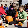 Anna Lowe, a fifth-grader at Utica Elementary School, seperatest the seeds from the goop in her pumpkin on Wednesday. Students performed an experiment to see if there was a correlation between pumpkin size and the number of seeds they contained. Staff photo by Jerod Clapp