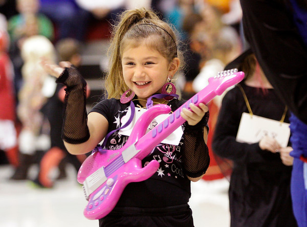 First-grader Camilla Adams walks around the gymnasium in her rock star costume during the St. Paul Catholic School Parade of Costumes in Sellersburg on Wednesday afternoon. Staff photo by Christopher Fryer