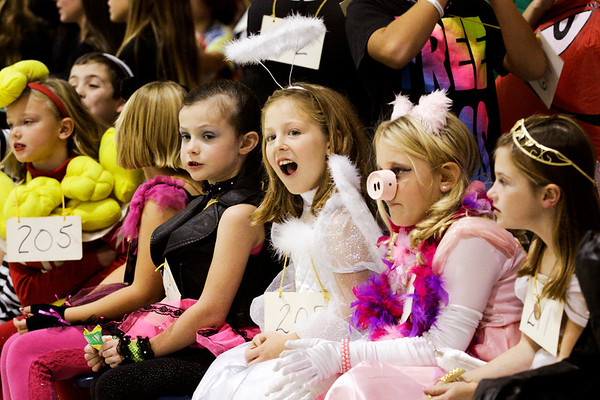 Second-graders from Mrs. Naville's class watch as their school mates walk around the gymnasium during the St. Paul Catholic School Parade of Costumes in Sellersburg on Wednesday afternoon. Staff photo by Christopher Fryer