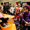 Tina Short, of At Your Service Remodeling in Clarksville, hands out candy to the Cooke sisters, all of New Albany, from right, Hanna, 10, dressed as Batterina, Madison, 8, dressed as a jester, and Victoria, 16, dressed as a clown, during the 26th annual Costume Carnival in Newlin Hall at the Floyd County 4-H fairgrounds in New Albany on Wednesday night. Staff photo by Christopher Fryer