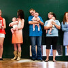 Participants wait to be judged on stage during the fourth annual baby contest at the Clark County 4-H Fair on Saturday afternoon. This year had the largest turnout of the last 4 years with 35 babies, ages 0-18 months, participating in the event. Staff photo by Christopher Fryer