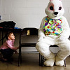 Desmond Schlatter sneaks a look at the Easter Bunny following a egg hunt Saturday morning at the Utica Community Center. Staff photo by C.E. Branham