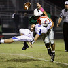 Floyd Central defensive lineman Jacob Trudeau sacks Jennings County quarterback Conner Byram during their game at Floyd Central on Friday. Staff photo by Christopher Fryer