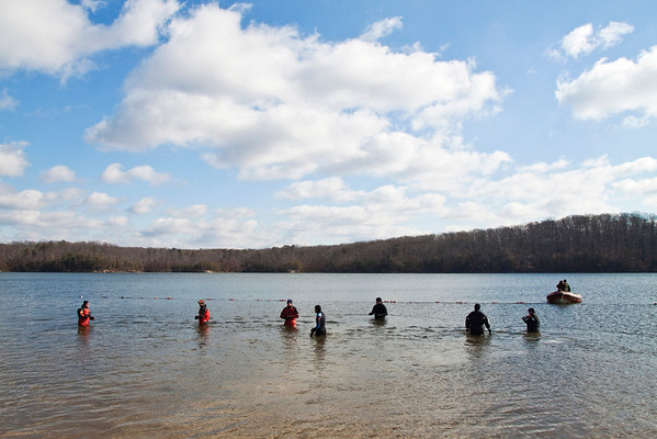 Divers with the Indiana State Police position themselves in the water before the start of the Special Olympic's sixth annual Polar Plunge at Deam Lake on Saturday morning. More than 375 participants took part in the event. Staff photo by Christopher Fryer