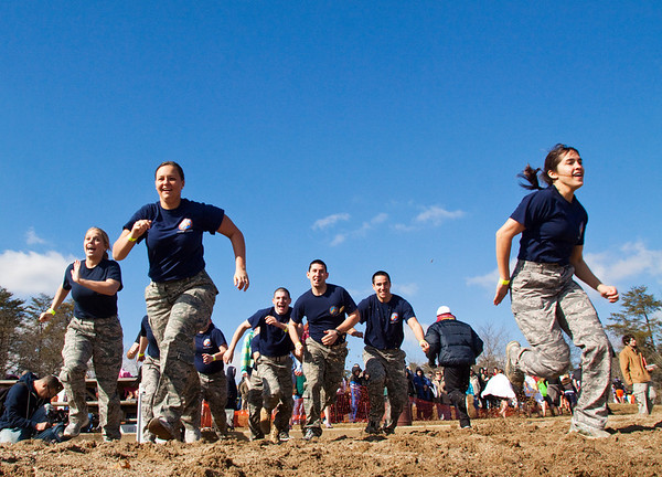 Members of the University of Louisville's Air Force ROTC make their way to the water during the Special Olympic's sixth annual Polar Plunge at Deam Lake on Saturday morning. More than 375 participants took part in the event. Staff photo by Christopher Fryer