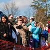 Spectators look on as plungers participate in the Special Olympic's sixth annual Polar Plunge at Deam Lake on Saturday morning. More than 375 participants took part in the event. Staff photo by Christopher Fryer