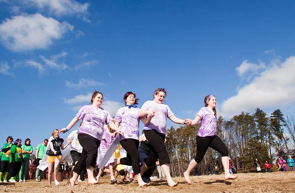 Members of the Henryville High School Key Club make their way to the water during the Special Olympic's sixth annual Polar Plunge at Deam Lake on Saturday morning. More than 375 participants took part in the event. Staff photo by Christopher Fryer