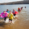 A group of friends from Jeffersonville, that themed their plunger group after Pac-Man the video game, make their way out of the water during the Special Olympic's sixth annual Polar Plunge at Deam Lake on Saturday morning. More than 375 participants took part in the event. Staff photo by Christopher Fryer
