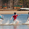 Plungers head into the water during the Special Olympic's sixth annual Polar Plunge at Deam Lake on Saturday morning. More than 375 participants took part in the event. Staff photo by Christopher Fryer