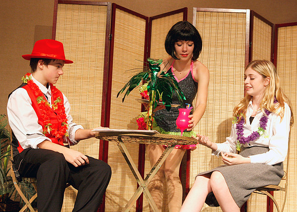 "Shawn Stepp, Breann Hendrickson and Kelsey Bottoff act out a scene in the New Washington Drama Club's production of ""Guys and Dolls."" The show opens Friday and runs through Saturday. Staff photo by Jerod Clapp"