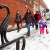 Members of the Holcomb, Polk and Dickens families, all of Jeffersonville, walk along Maple Street between destinations on the third annual Holiday Cookie Stroll in downtown Jeffersonville on Saturday afternoon. Twenty one downtown businesses participated in the event put on by Jeffersonville Main Street Inc. Staff photo by Christopher Fryer