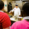Chef Louis Retailleau demonstrates how to cook a crepe for Floyd County Youth Shelter residents during a cooking class at the facility in the Pineview Government Center in New Albany on Friday morning. The class was put together with a grant from the Floyd Memorial Foundation for life skills training. After his next session at the facility later this month, Retailleau will choose a stand out student to assist him at his French restaurant, Louis Le Fracais, in downtown New Albany. Staff photo by Christopher Fryer