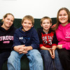 Breah Watteau, left, sits with her children Katelin, 16, and Brayden Watteau, 9, and Jaiden Miller, 10, in their New Albany home. Staff photo by Christopher Fryer
