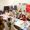 Participants work on arts and crafts projects and play traditional African musical instruments during the 12th annual Kwanzaa Celebration at the Jeffersonville Township Public Library on Saturday afternoon. Staff photo by Christopher Fryer
