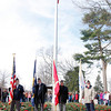 A color guard team from the American Legion Post 204 from Sellerburg takes their place in front of the national flag at the New Albany National Cemetery on Friday. Students from Hazelwood Middle School placed wreaths at the graves of soldiers. Staff photo by Jerod Clapp