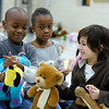 Zyon Bradley, Kaila Brown and Sutton Watson, first-graders at Maple Elementary School in Jeffersonville, play with their new stuffed animals during the school's event, Bears on Parade. In 12 years, the event has given about 14,000 animals to students in the school. Staff photo by Jerod Clapp