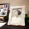 Floyd Memorial Foundation Executive Director Ruth Heideman's 1968 Indiana University Southeast Nursing School graduation photo sits in a frame with other photographs and mementos at her retirement reception in the cafeteria at Floyd Memorial Hospital in New Albany on Wednesday afternoon. Staff photo by Christopher Fryer