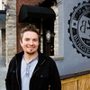 Owner Matt McMahan, Floyds Knobs, stands outside of his restaurant Big Four Burgers + Beer at 134 Spring St. in Jeffersonville on Tuesday evening. The establishment is scheduled to open for business today. Staff photo by Christopher Fryer