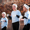 From left, Motion Studio dancers Sydney Crosser, 8, New Albany, Emily Pearce, 10, Georgetown, and Alexa Young, 8, New Albany, perform at the corner of State and Market streets during HolidayFest in downtown New Albany on Saturday afternoon. Staff photo by Christopher Fryer