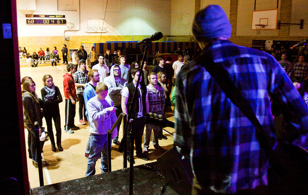 Attendees look on as the rock band The Weekend Classic from Madison performs during ToyFest at the Griffin Street Center in New Albany on Saturday evening. The inaugural event, put on by the New Albany Production House and the New Albany Parks Department, had 17 bands and solo performers, and proceeds from the event will be used to purchase toys for underprivileged children in the area. Staff photo by Christopher Fryer