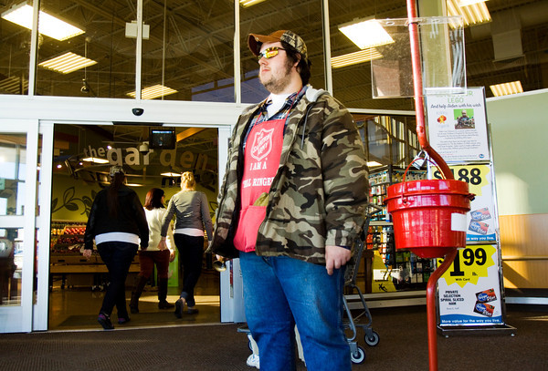 Bell ringer Bryant Sears, Clarksville, mans a Salvation Army donation kettle at Kroger along Lewis and Clark Parkway in Clarksville on Wednesday afternoon. Staff photo by Christopher Fryer