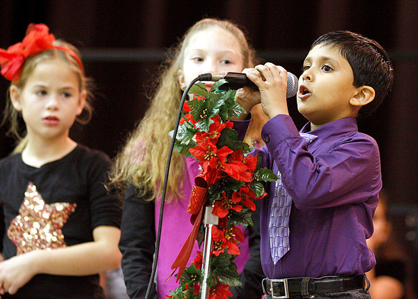 "Siddarth Bhatt, a second-grader at W. E. Wilson Elementary School in Jeffersonville, speaks his part during the school's ""Holidays Around the World"" program. The program showed how different holidays are celebrated around the globe. Staff photo by Jerod Clapp"