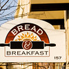 A sign for Bread and Breakfast hangs above the front entrance to the bakery located at the corner of Bank and Main streets in downtown New Albany. Staff photo by Christopher Fryer