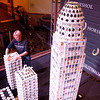 Bryan Berg, a world record holding card stacker, builds the Galt House towers as part of his Louisville skyline installation at Horseshoe Southern Indiana in Elizabeth on Thursday. Berg said he expected to use about 1,000 decks of bridge cards to complete the skyline. Staff photo by Jerod Clapp