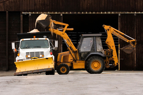 A crew with the New Albany Street Department prepares their equipment to condition local road ways for the winter weather that is forecast to move through the area early tomorrow morning. Staff photo by Christopher Fryer