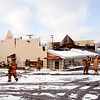 New Albany firefighters pack up their gear on Tuesday morning after working the scene of a structure fire that started late Monday night at Sam's Food and Spirits near the intersection of Payne Koehler and Charlestown roads in New Albany. Staff photo by Christopher Fryer